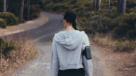 Fitness woman on cross country path