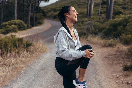 Fitness woman warming up before a run