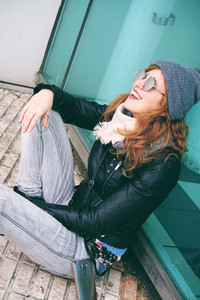 Cool young woman enjoying the day outdoors