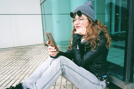 Young influencer woman using her smartphone
