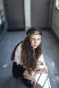 Hippie woman sitting on floor