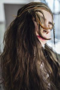 Hippie woman shaking hair