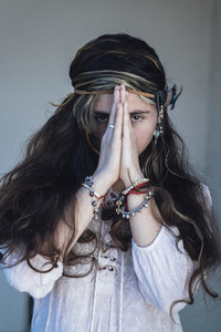 Ethic woman clasping hands and praying