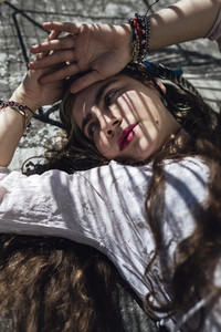 Smiling hippie woman lying on floor