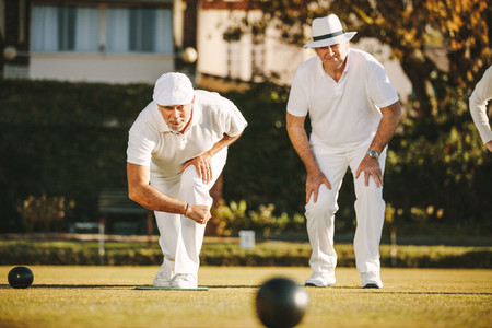 Old men playing a game of boules