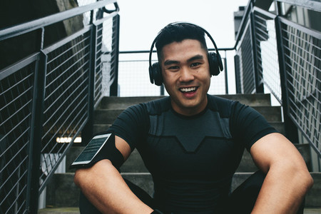 Asian man taking break after training session