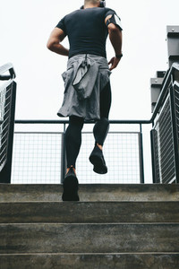 Fit young man running up stairs