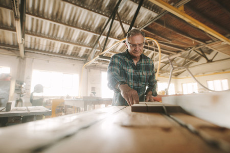 Senior carpenter manufacturing wooden products
