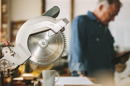 Circular wood saw in carpentry workshop