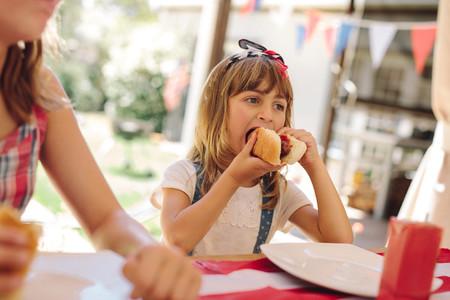 Little girl eating snacks at a restaurant