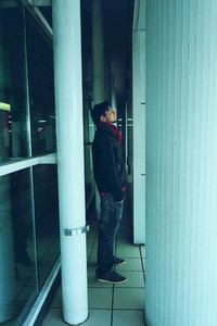 Young man alone in a bus station at night