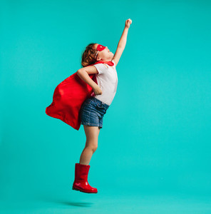 Girl child play a superhero