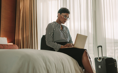 Woman doing business from hotel room