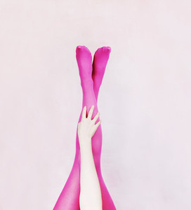 Female legs wearing pink tights