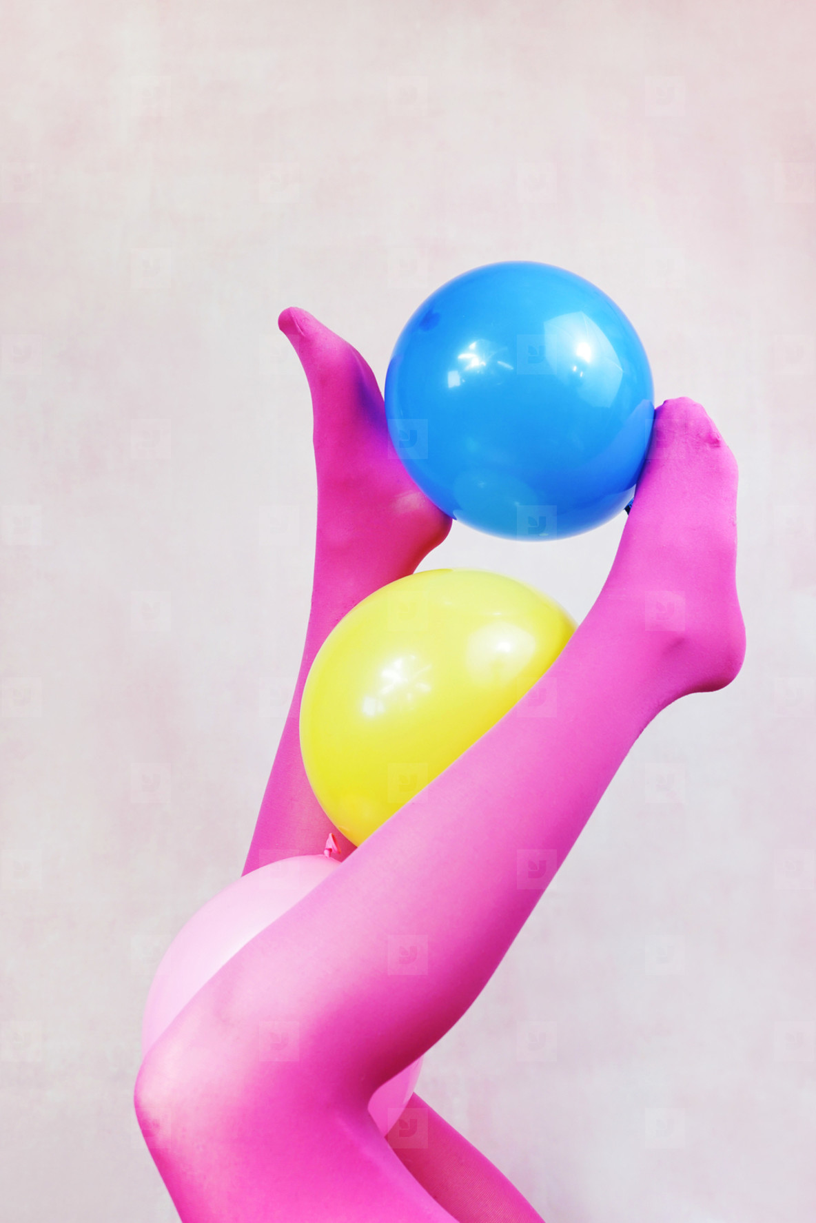 Pop art about legs wearing pink tights and holding balloons