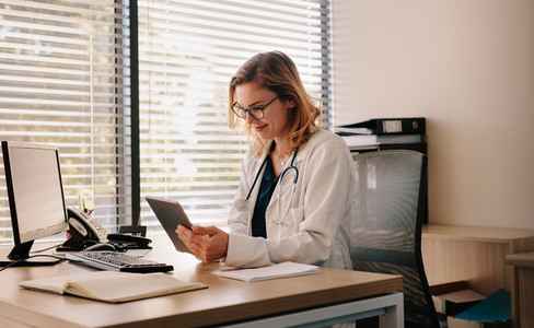 Female doctor working on her tablet pc