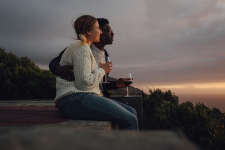 Interracial couple admiring the sunset