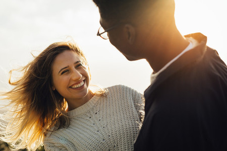 Smiling woman looking at her boyfriend
