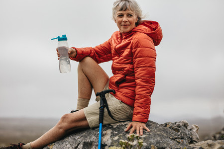 Woman hiker relaxing after the trek