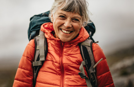 Portrait of a smiling woman on a hiking trip