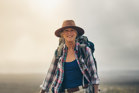 Portrait of a cheerful senior woman in hat