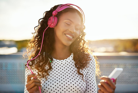 Girl in pink headphones