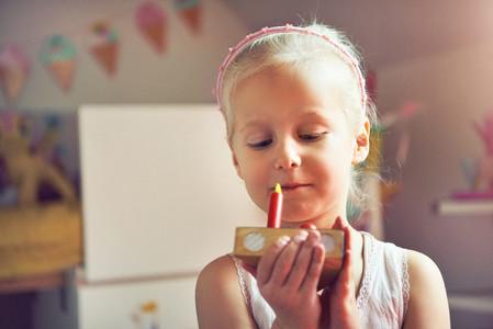 Little kid holding slice of toy cake