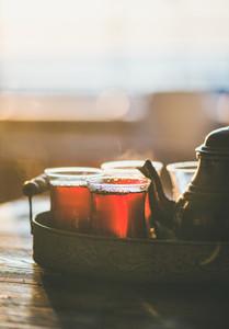 Freshly brewed black tea in turkish tukip glasses copy space