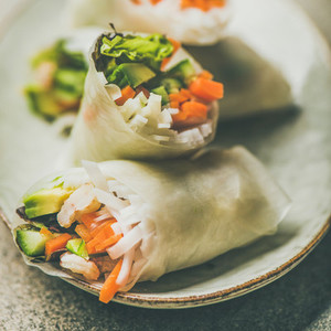 Shrimp and vegetable rice paper rolls on plate  square crop