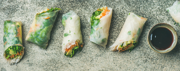 Vegan spring rice paper rolls with chopsticks  wide composition