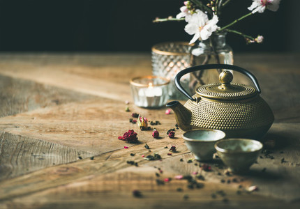 Traditional Asian tea ceremony arrangement over wooden background copy space