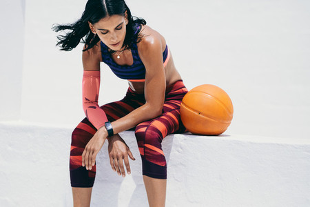 Female athlete taking a break from workout