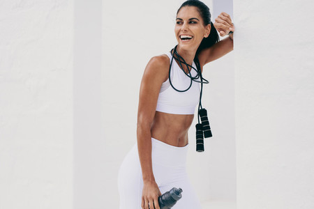 Smiling fitness woman taking a break after workout