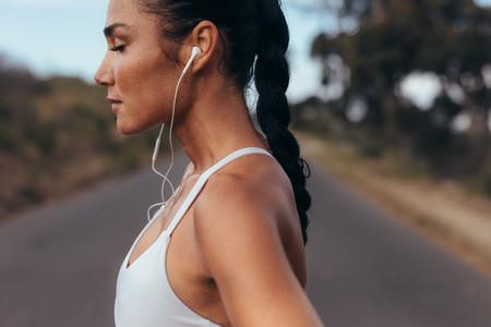 Female runner listening to music
