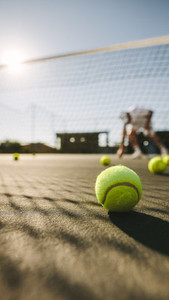 Tennis balls lying on the ground on a tennis court