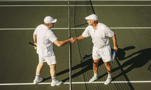 Tennis players greeting each other after a game of tennis