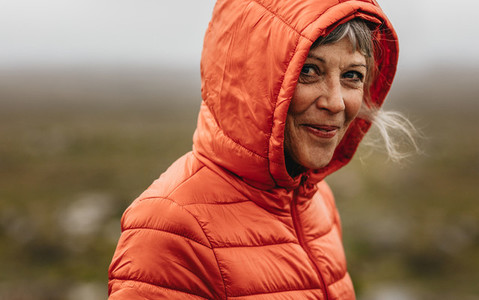 Portrait of a senior woman wearing hooded jacket