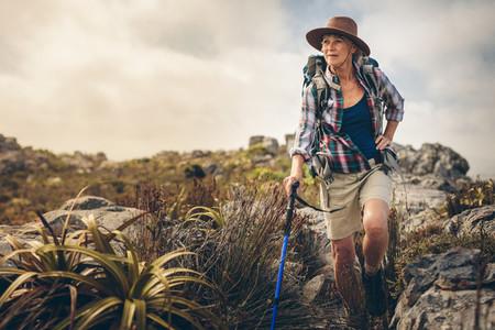 Adventurous senior woman on a hiking trip
