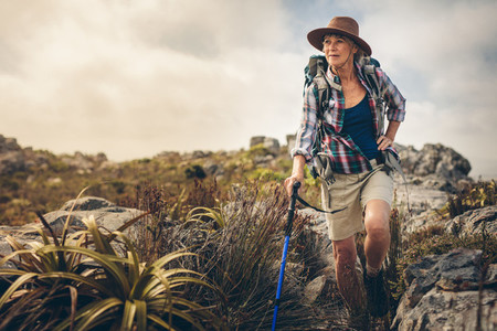 Adventurous senior woman on a hiking trip