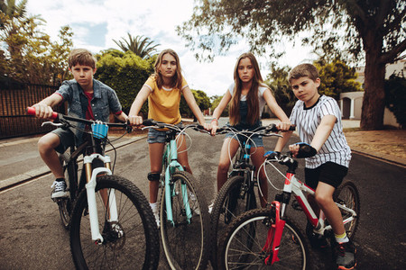 Boys and girls on bicycles in a street
