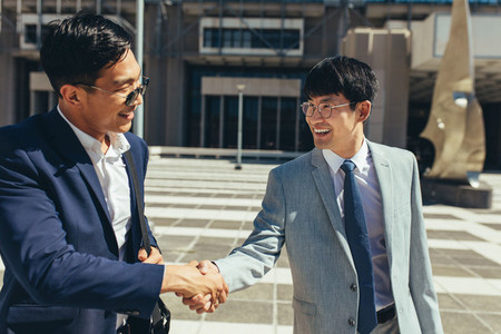 Two successful business men shaking hands