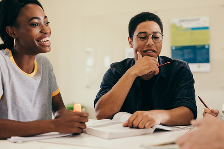 Multi ethnic students doing group study