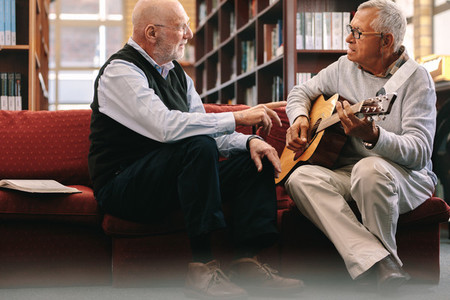 Senior men playing guitar