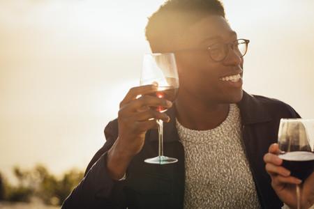 Couple enjoying with wine on picnic