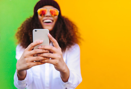 Curly haired african girl taking a selfie