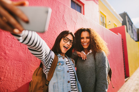 Excited female travelers taking selfie