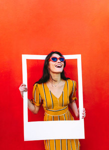 Stylish woman with large photo frame