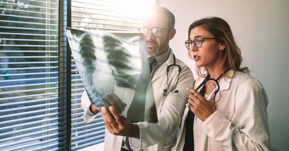 Doctors diagnosing patient illness using x ray