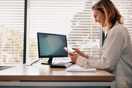 Female doctor using her digital tablet in the consultation
