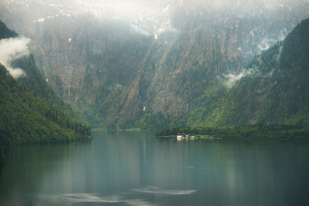 View over misty Lake Konigssee in Bavaria